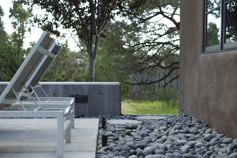 Concrete patio with Mexican beach pebbles