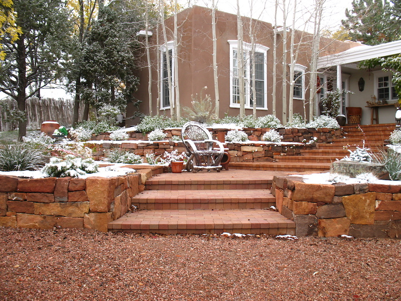 Stone walls with brick paver entry