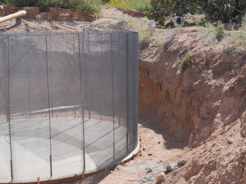 Beginning construction on a steel and concrete water storage tank